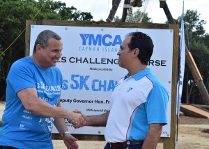 7 Andrew Johnson of the YMCA congratulates Deputy Governor